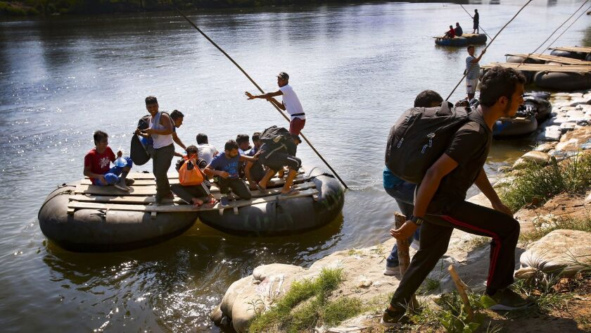 JANUARY 17, CIUDAD HILDAGO, MEXICO Some migrants who used the float raft to cross into Mexico illega
