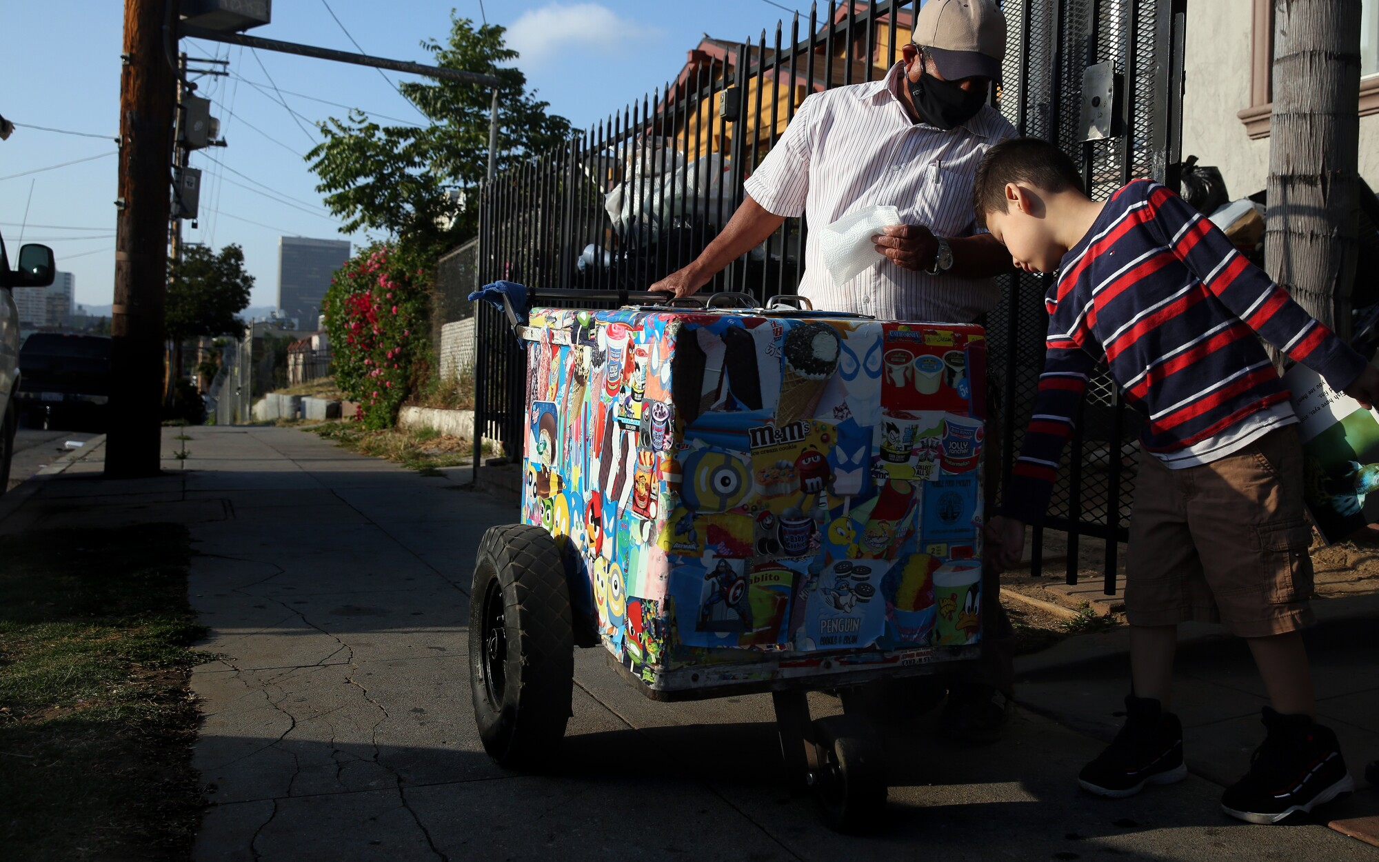 Mauro Rios Parra sells a paleta to Matthew Chicas, 6, in Los Angeles.