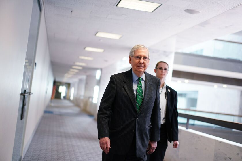 Majority Leader Mitch McConnell (R-Ky.) arrives for the Republican policy luncheon at the Hart Senate Office Building.