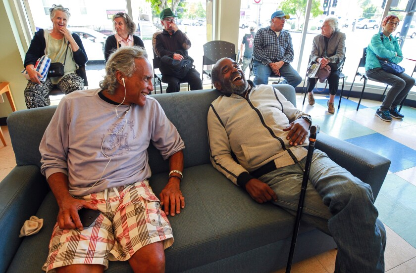 Victor Quslan shared a laugh with Carl Russell at the Gary and Mary West Senior Wellness Center in downtown San Diego.