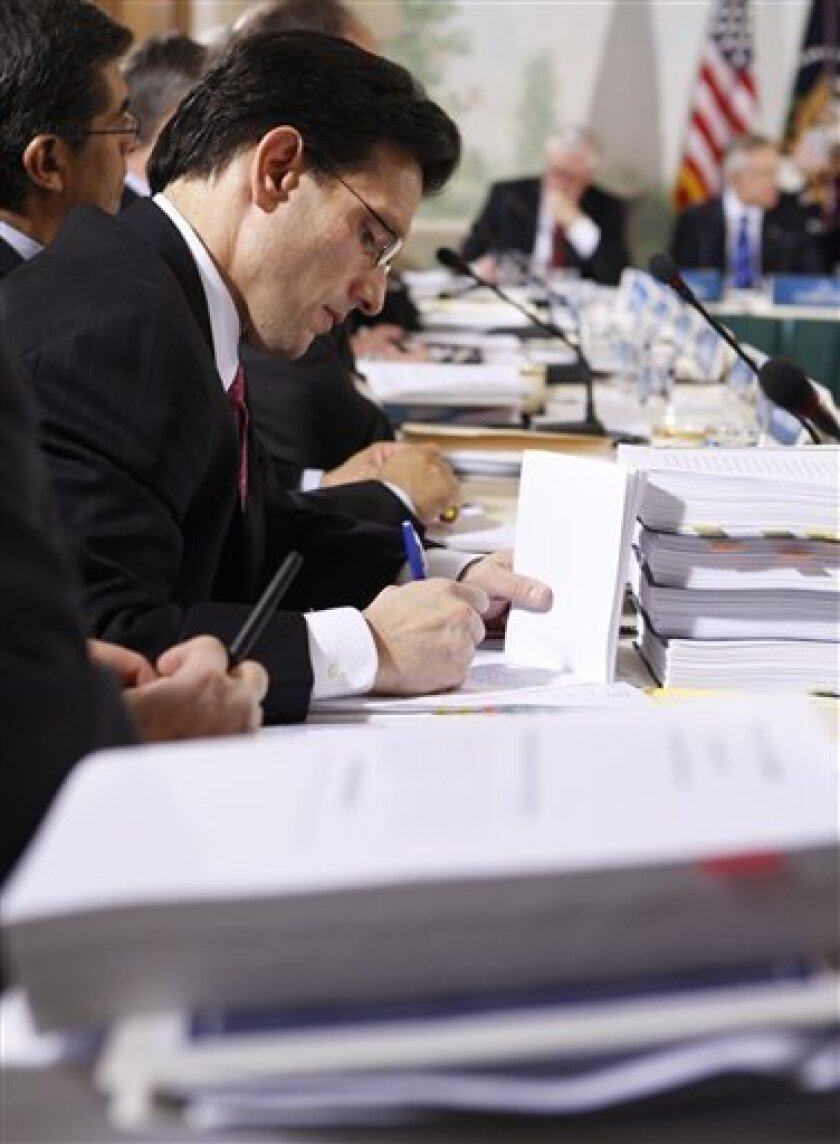 House Minority Whip Rep. Eric Cantor of Va., takes notes during a meeting on health care reform with President Barack Obama, Thursday, Feb. 25, 2010, in the Blair House in Washington. (AP Photo/Pablo Martinez Monsivais)