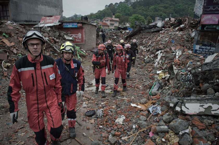 French rescue workers walk among earthquake debris as they look for survivors in Katmandu, the capital of Nepal, on April 28.
