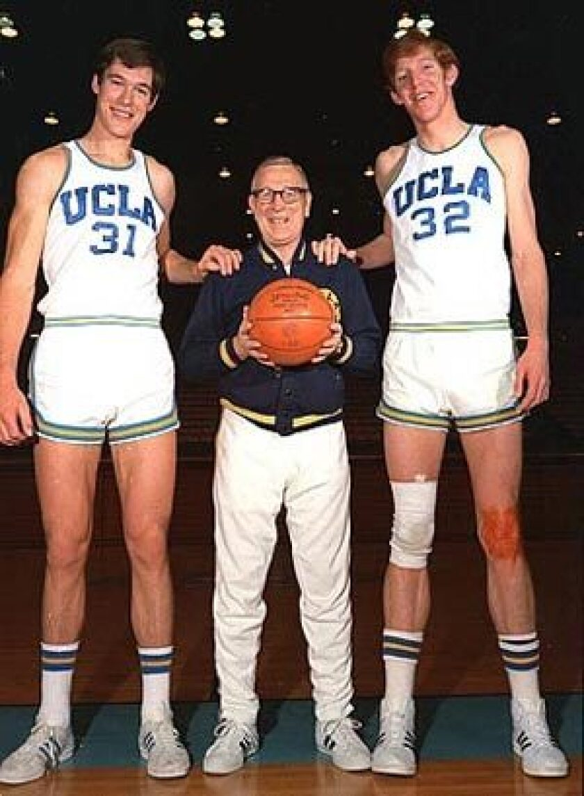 The 1972 team had no shortage of height: Wooden is dwarfed by centers Swen Nater, left, and Bill Walton. Players didn't always see eye to eye with Wooden, but they knew that breaking the rules would result in punishment no matter how valuable they were to the team's success. See full story