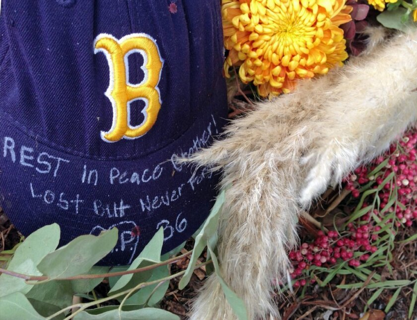 A roadside memorial to UCLA football player Nick Pasquale is seen near where he was struck and killed by a car on Camino De Los Mares in San Clemente on Monday.