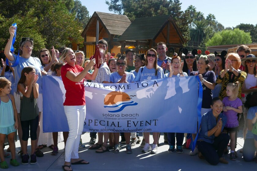 Head of School, Shawn Edwards, marks the official grand opening of LePort Solana Beach, with a ribbon-cutting ceremony.
