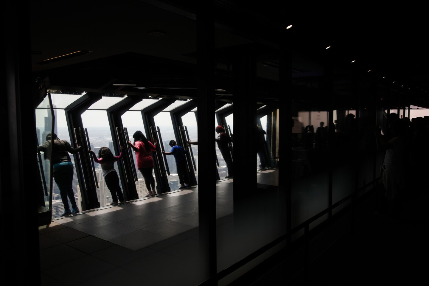 Visitors on the Tilt on the 360 Chicago observation deck of 875 N. Michigan Ave. (formerly called the John Hancock Center) in Chicago on May 14, 2018.