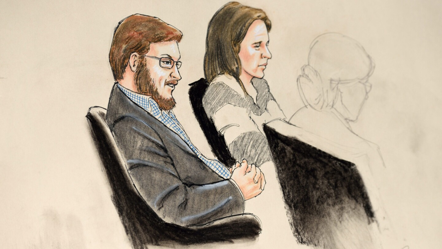 A courtroom sketch showing James Holmes with Arapahoe County Public Defender Tamara Brady at the Arapahoe District Courthouse in Centennial, Colo.