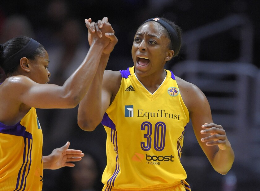 Sparks forward Nneka Ogwumike celebrates with guard Alana Beard during the second half of a game against the Tulsa Shock on Aug. 6.