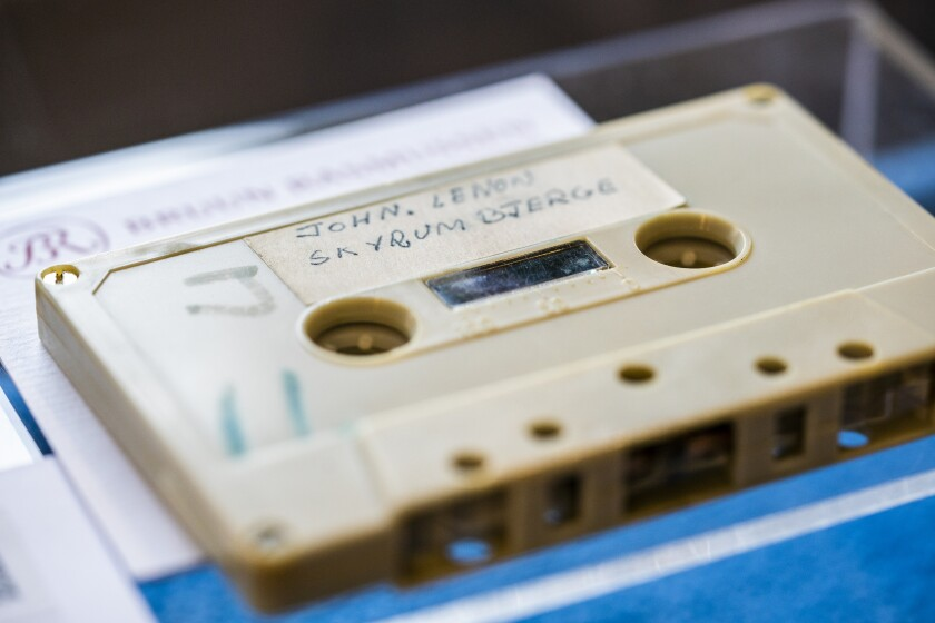 FILE - In this Friday, Sept. 24, 2021 file photo, a view of a cassette with the recording of four Danish schoolboys' interviews with John Lennon and Yoko Ono during the famous couple's winter stay in Thy, in Jutland, Denmark, in 1970, on display at Bruun Rasmussen Auction House in Copenhagen. A cassette with a 33-minute audio recording of John Lennon, who was interviewed by four Danish teenagers for their school paper, and an apparently unpublished song by the late Beatle, has fetched 370,000 kroner ($58,240) at an auction Tuesday, Sept. 28, 2021. (Ida Marie Odgaard/Ritzau Scanpix via AP, File)