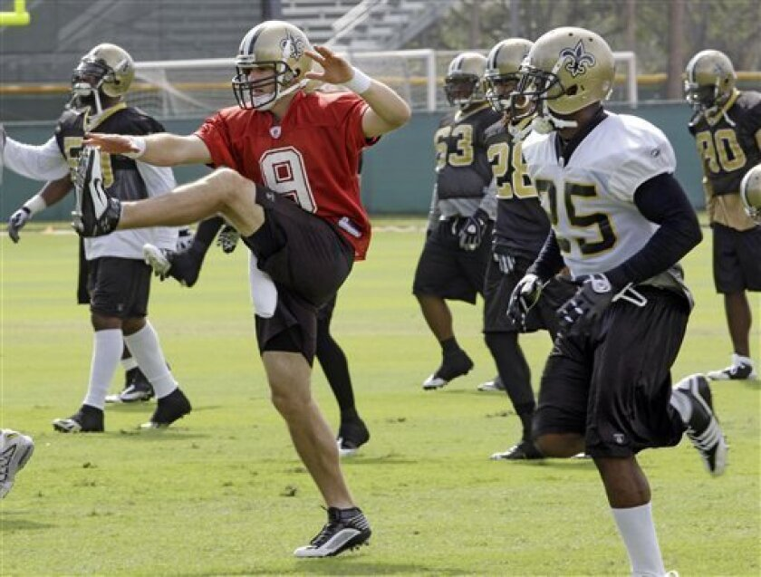 New Orleans Saints quarterback Drew Brees (9) and running back Reggie Bush (25) loosen up during football practice on Friday, Feb. 5, 2010 in Miami. The Saints play the Indianapolis Colts in NFL football Super Bowl XLIV on Sunday, Feb. 7 in Miami. (AP Photo/Mark Humphrey)