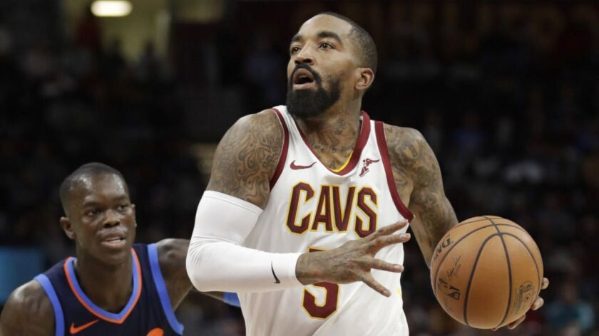 Cleveland Cavaliers' JR Smith (5) drives past Oklahoma City Thunder's Dennis Schroder (17) in the first half game on Nov. 7, 2018 in Cleveland.