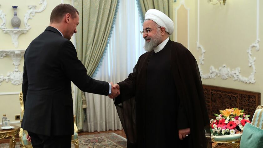 Iran's President Hassan Rouhani, right, welcomes French diplomat Emmanuel Bonne in Tehran in an image provided by the Iranian government on July 10. European nations have been working with Iran on a trade agreement.