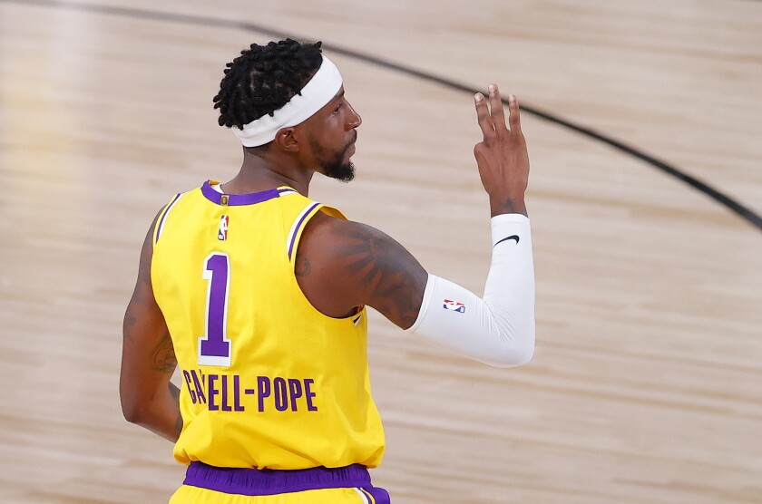 Lakers guard Kentavious Caldwell-Pope reacts after his three-pointer against the Trail Blazers during their playoff series.
