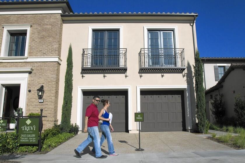 The number of Southern California homes bought for $2 million or more in recent months is the highest on record. Above, Rafael Lopez, left, and his wife, Jacqueline, step out of a model luxury home in Irvine's Orchard Hills community.