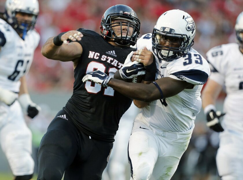 North Carolina State defensive end Drew Davis (91) tries to stop Old Dominion running back Ray Lawry (33) during the first half of an NCAA college football game at Carter-Finley Stadium in Raleigh, N.C., Saturday, Sept. 6, 2014. (AP Photo/The News & Observer, Ethan Hyman) MANDATORY CREDIT
