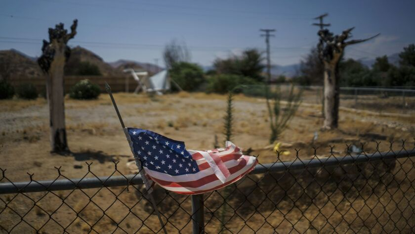 A tattered American flag flutters outside an abandoned property in the South Lake neighborhood that