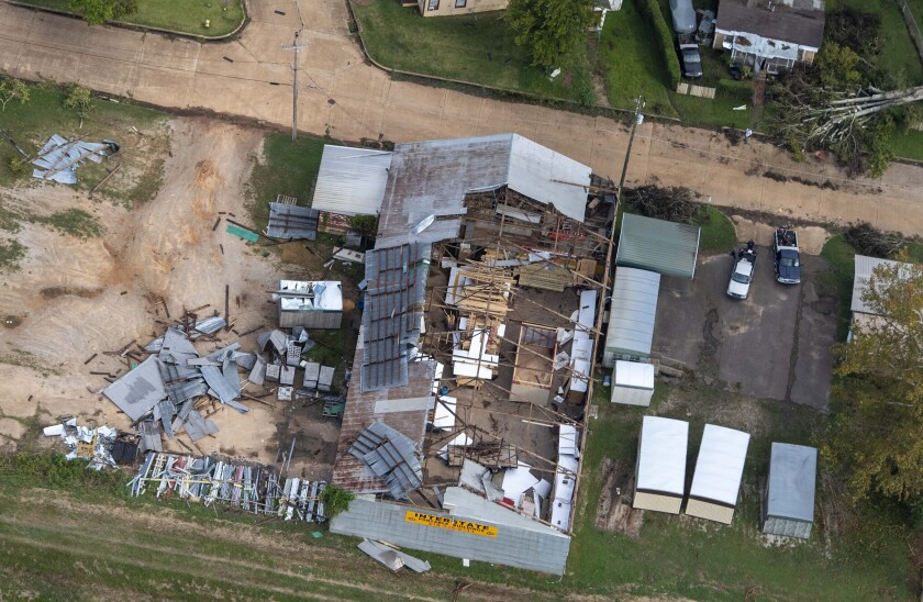 A home that lost its roof to Hurricane Laura in Pineville, La.
