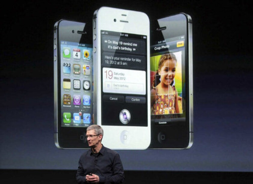 Apple Chief Executive Tim Cook unveiling the iPhone 4S in 2011.