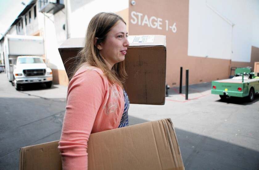 """""""Witches of East End"""" production assistant Amy Thurlow carries boxes from the mailroom at Sunset Bronson Studios in Hollywood."""