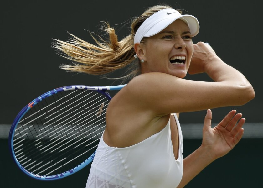 ADVANCE FOR WEEKEND EDITIONS, AUG. 29-30 - FILE - In this July 3, 2015, file photo, Maria Sharapova returns a ball to Irina-Camelia Begu during their singles match at the All England Lawn Tennis Championships in Wimbledon, London. Sharapova is seeded third for the U.S. Open tennis tournament. (AP Photo/Pavel Golovkin, File)