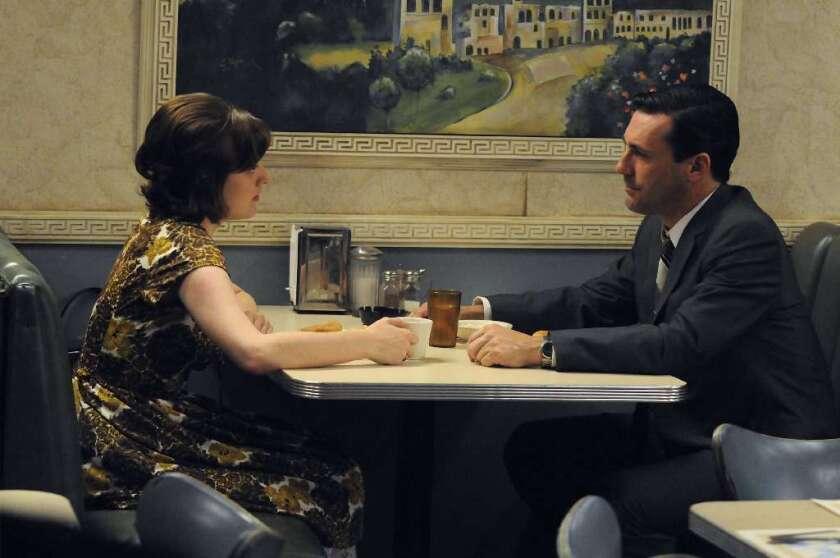 "Elisabeth Moss and Jon Hamm bond over bad coffee in ""Mad Men."""