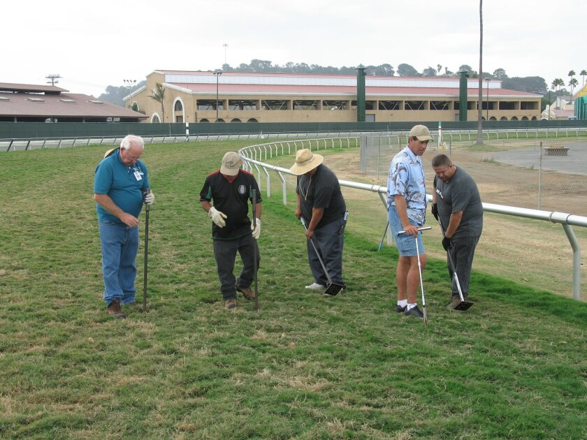 Del Mar turf superintendent Leif Dickinson tends to the race course with his crew, (from left) Henry Nordbrok, Rafael Zarate, Victor Bernardino and Art Moreno.