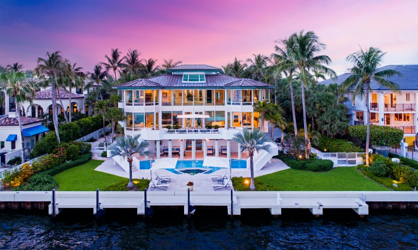 Spanning 8,300 square feet, the waterfront mansion holds six bedrooms, 7.5 bathrooms and a handful of chic, glass-filled living spaces.