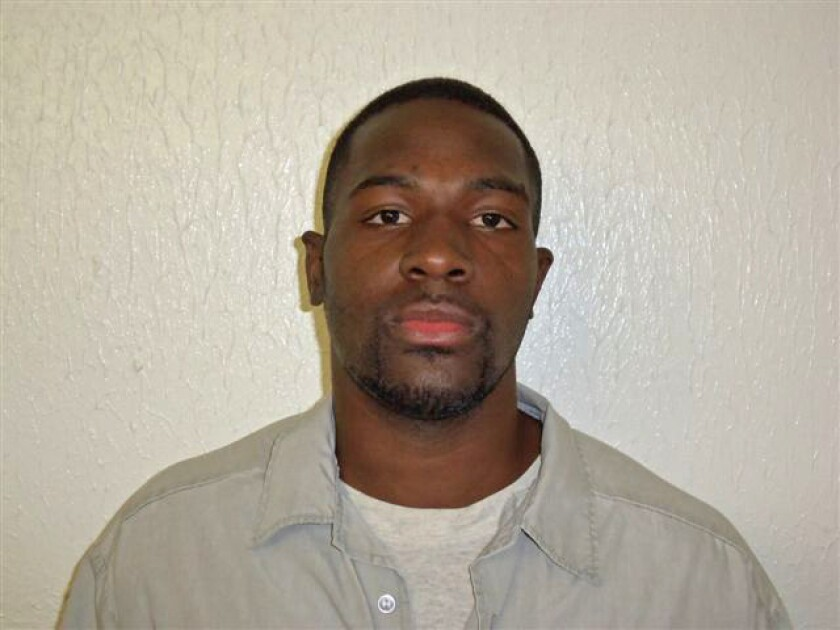 Alton Nolen, who is suspected of beheading a coworker at a Moore., Okla., food processing plant, in a 2011 Oklahoma Department of Corrections photo.