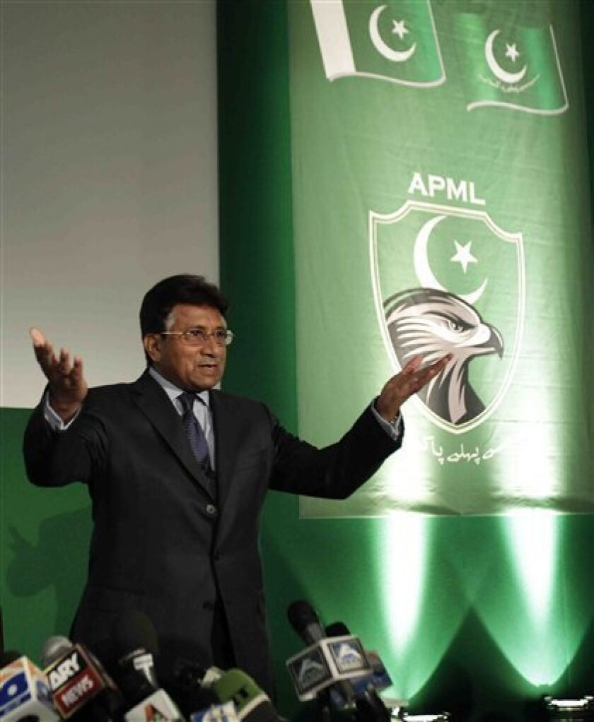 """Pervez Musharraf, the former President of Pakistan, aknowledges the applauf of his supporters as he arrives for the announcement of the launch of his new political party, the """"All Pakistan Muslim League"""" in central London, Friday Oct. 1, 2010. (AP Photo/Lefteris Pitarakis)"""