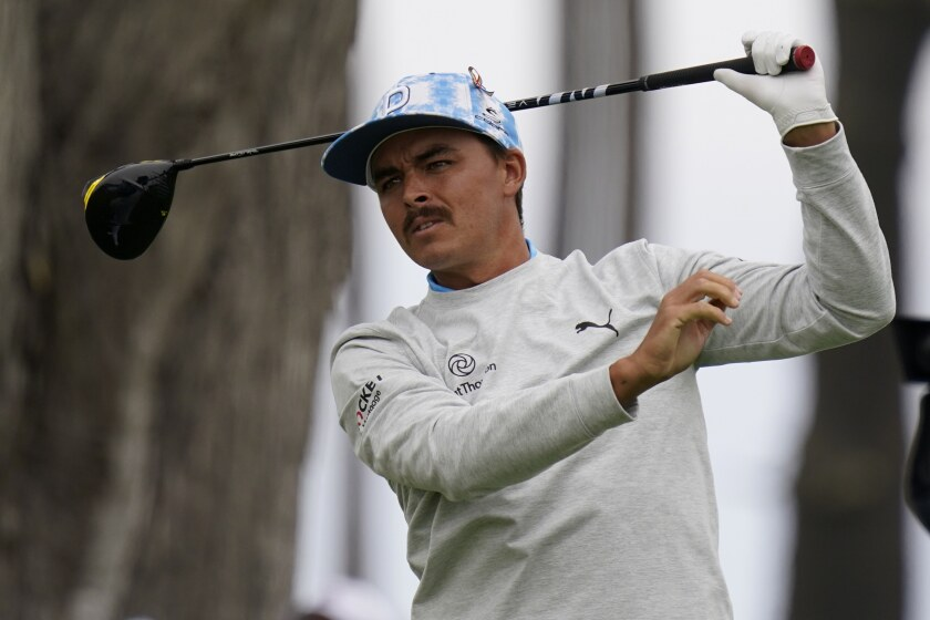 Rickie Fowler watches his tee shot on the seventh hole during the first round of the PGA Championship golf tournament at TPC Harding Park Thursday, Aug. 6, 2020, in San Francisco. (AP Photo/Jeff Chiu)