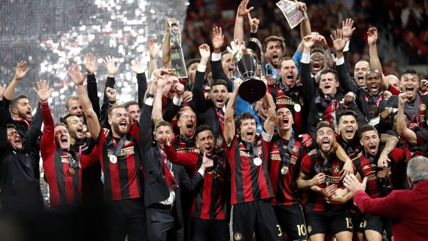 Atlanta United players celebrate after defeating Portland Timbers 2-0 to win the MLS Cup championshi