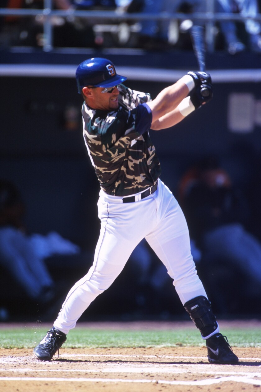 Padres third baseman Phil Nevin bats on April 13, 2000, at Qualcomm Stadium. This game marked the first time the Padres wore camouflage jerseys to honor the military.