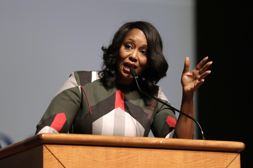 FILE - In this Oct. 23, 2019 file photo, Maya Rockeymoore Cummings speaks during a viewing service at Morgan State University, in Baltimore. The widow of U.S. Rep. Elijah Cummings has resigned as Maryland's Democratic Party chair to run for her late husband's congressional seat. News outlets report Rockeymoore Cummings plans to formally announce her campaign at her Baltimore home Tuesday morning, Nov. 12. Congressman Elijah Cummings died last month at the age of 68. (AP Photo/Julio Cortez, File)