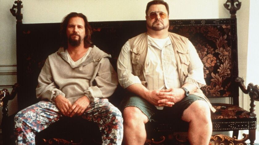 """Jeff Bridges and John Goodman sit next to each other in the film """"The Big Lebowski."""""""