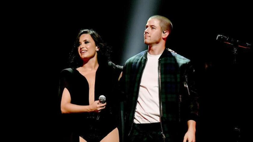Demi Lovato and Nick Jonas perform onstage during the kickoff of their Future Now tour on June 29 in Atlanta. (Kevin Mazur)