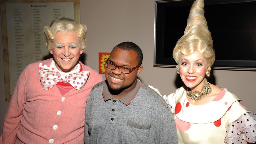 """Actors Robert Townsend and Jill Townsend with an audience member at the 2014 sensory-friendly performance of """"Dr. Seuss's How the Grinch Stole Christmas!"""""""