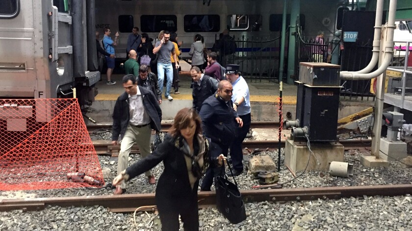 Passengers rush to safety after a New Jersey commuter train crashed into the platform at the Hoboken station on Sept. 29.