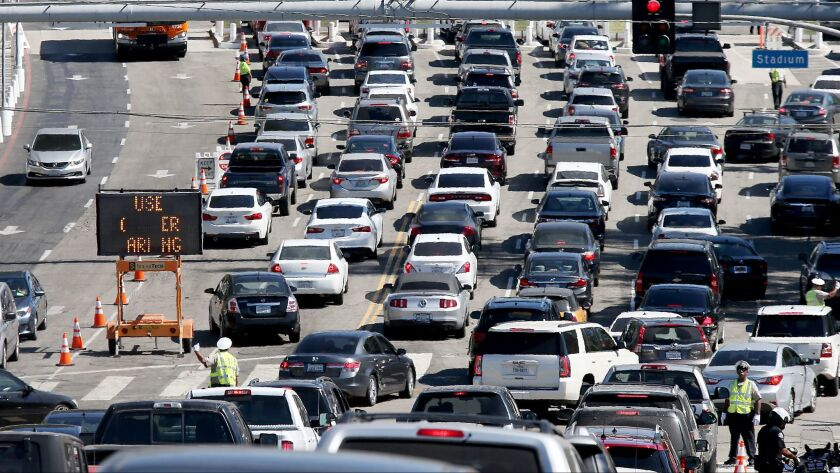 Traffic streams in to the parking lot of Dodger Stadium on Oct. 10.
