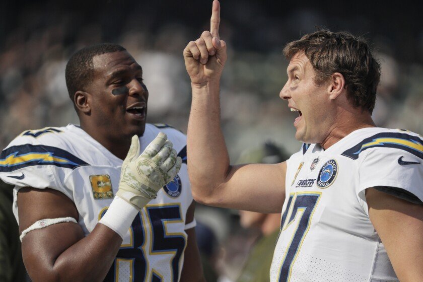Antonio Gates, left, and Philip Rivers share a moment on the sidelines, something they've done for the previous 15 seasons.