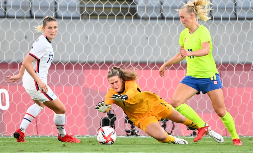 USA goalie Alyssa Naeher makes a save.