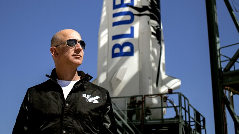 Jeff Bezos, Amazon CEO and the founder of the aerospace company Blue Origin, prepares to watch the maiden voyage of the company's New Shepard rocket at Blue Origin's west Texas launch facility.