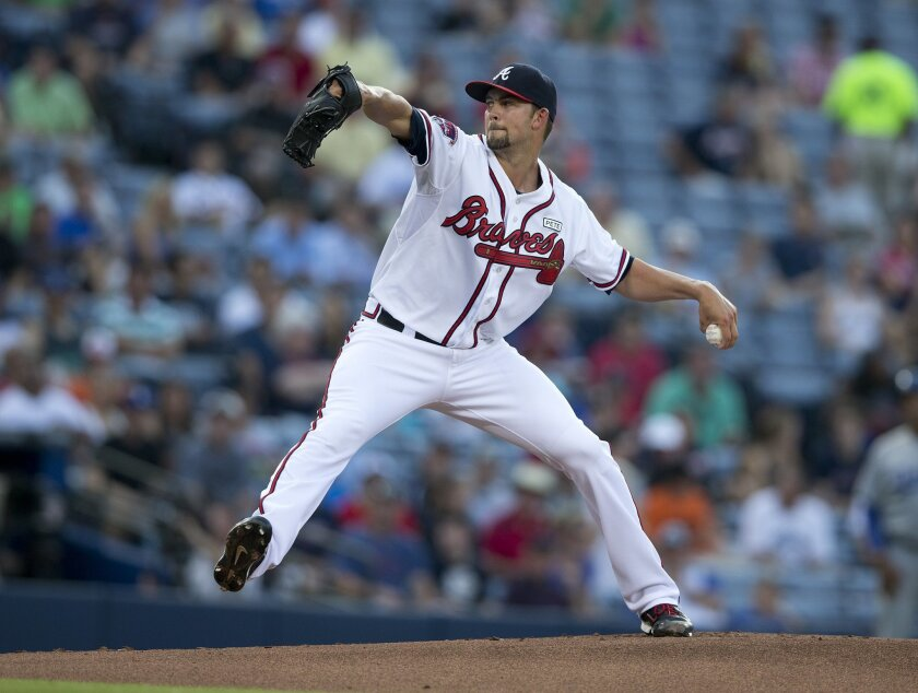 Atlanta Braves starting pitcher Mike Minor (36) works in the first inning of a baseball game against the Los Angeles DodgersTuesday, Aug. 12, 2014, in Atlanta. (AP Photo/John Bazemore)