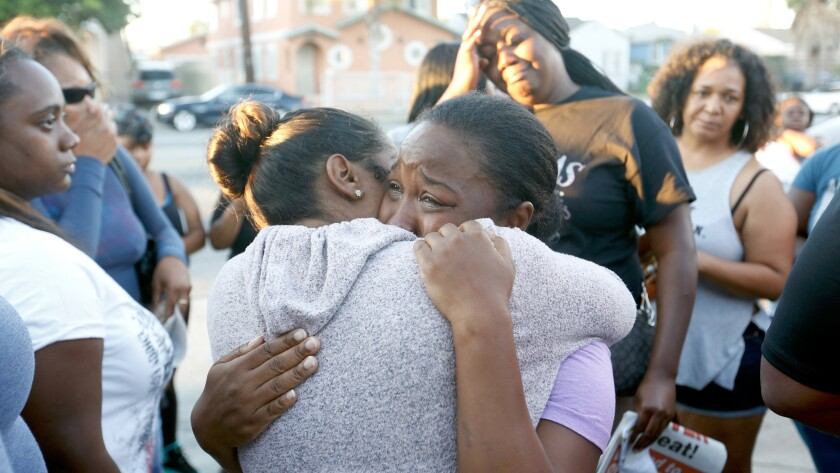 Prescious Sasser, mother of Kenney Watkins, cries during a prayer vigil in South Los Angeles on Wednesday.