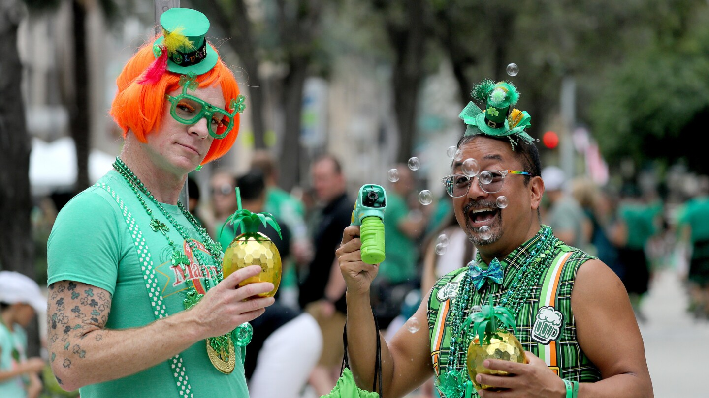 Crowds lined Las Olas Boulevard for the annual St. Patrick's Day parade in Fort Lauderdale. Mike Stocker / South Florida Sun-Sentinel