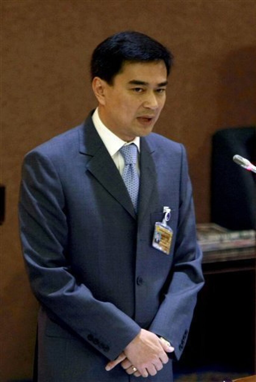 Thailand's Prime Minister Abhisit Vejjajiva addresses the parliament during the censure debate Tuesday, June 1, 2010 in Bangkok. Thailand's House of Representatives began debate on the second day Tuesday a censure motion against the coalition government of Prime Minister Abhisit, focusing on its deadly crackdown on anti-government Red Shirt protesters earlier this month. (AP Photo/Apichart Weerawong)