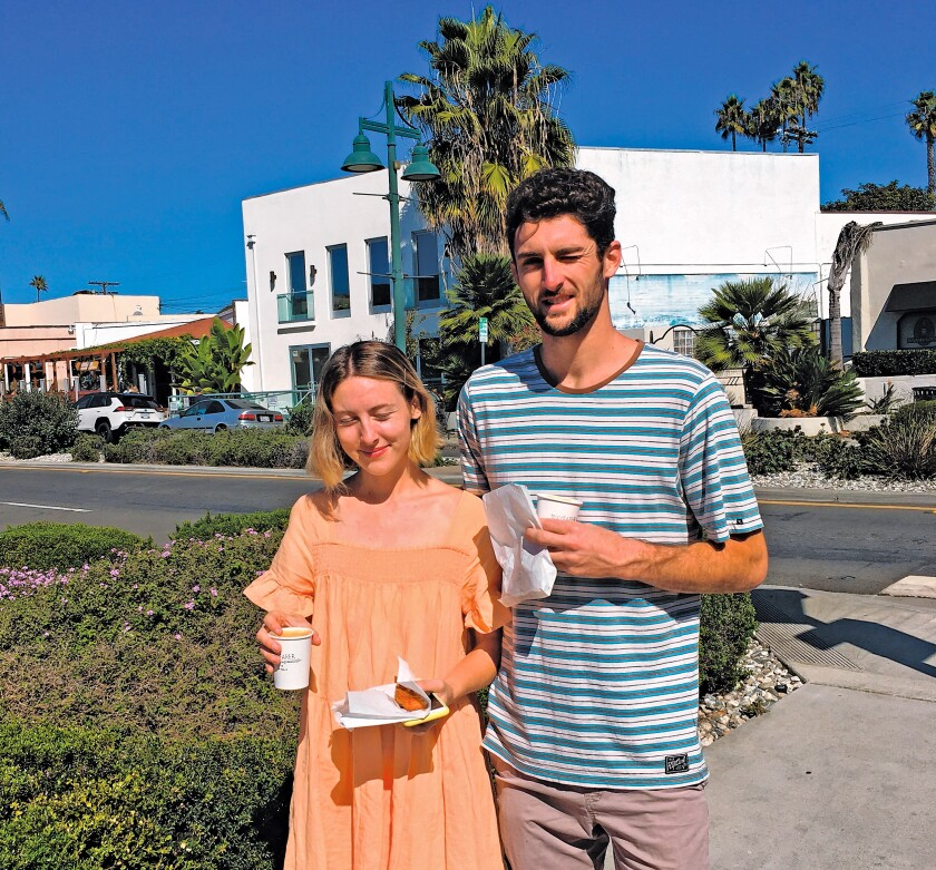 After crossing La Jolla Boulevard near a roundabout, Trevor Port and Makenzie Lowe report: 'It feels safer with cars going slower and drivers more aware.'