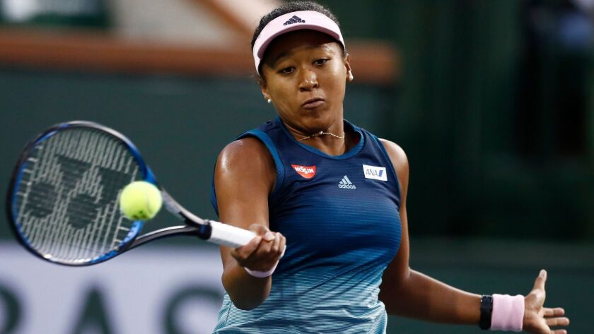 Naomi Osaka in action against Danielle Collins during the BNP Paribas Open at the Indian Wells Tennis Garden.