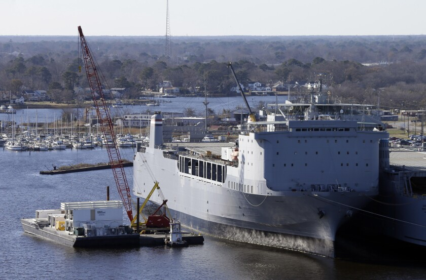 Workers in Portsmouth, Va., unload equipment Thursday from the Cape Ray, which will serve as the lynchpin for the international efforts to destroy Syria's chemical weapons. British officials announced Friday that their nation would destroy 165 tons of Syrian chemicals.