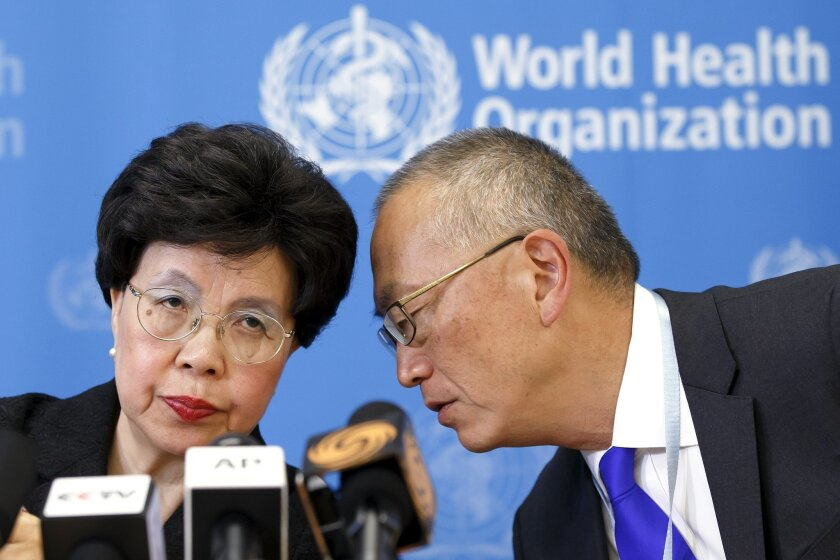 FILE - In this Friday, Aug. 8, 2014 file photo, Director-General of the World Health Organization (WHO) Dr. Margaret Chan, left, and Assistant Director-General of Health Security Keiji Fukuda, right, confer during a news conference after an emergency meeting at the WHO headquarters in Geneva, Switz