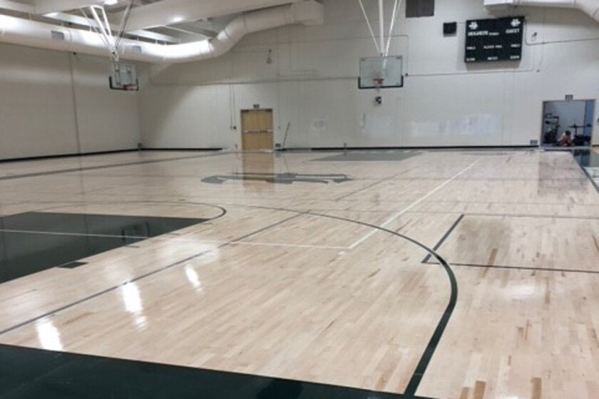 The new gym at Helix High is awaiting bleachers, but the floor is done. It's possible the basketball team will be able to practice there in November.